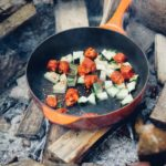 Roasting veggies over campfire