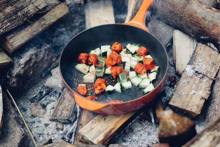 Roasting veggies over campfire